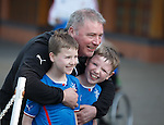 Ally McCoist meets some young fans as supporters group Sons of Struth take a party of kids on a tour of the training ground this morning