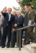 Washington, DC - August 31, 2007 -- United States President George W. Bush departs The Pentagon in Washington, D.C. after receiving briefings on the Iraq situation on Friday, August 31, 2007. From left to right: President Bush; Vice President Dick Cheney; Secretary of Defense Robert Gates; unidentified security agent; and Chairman,Joint Chiefs of Staff, General Peter Pace. <br /> Credit: Ron Sachs / CNP