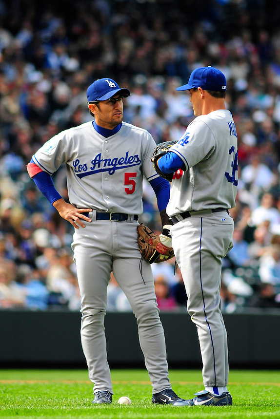 14 September 08: Los Angeles Dodgers pitcher Greg Maddux and 3rd baseman Nomar Garciaparra strategize during a game against the Colorado Rockies. The Colorado Rockies defeated the Dodgers 1-0 in 10 innings at Coors Field in Denver, Colorado. FOR EDITORIAL USE ONLY