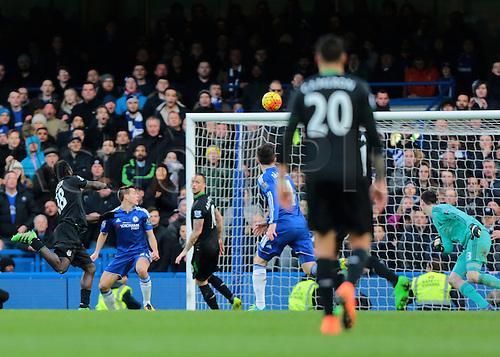 05.03.2016. Stamford Bridge, London, England. Barclays Premier League. Chelsea versus Stoke City. Stoke City Forward Mame Biram Diouf scores a rebound header past Chelsea Goalkeeper Thibaut Courtois (left) to level the score, 1-1