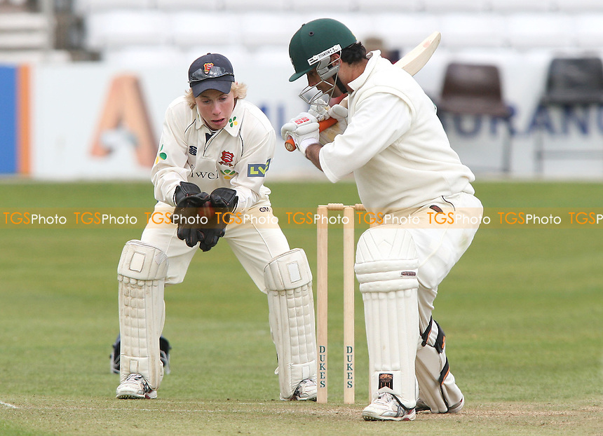 Essex wicket keeper Adam Wheater gathers the ball with Kabir Ali of Worcestershire looking on - Essex CCC vs Worcestershire CCC at The Ford County Ground, Chelmsford - 10/04/08 - MANDATORY CREDIT: Rob Newell/TGSPHOTO