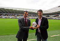 Pictured L-R: Sky Sports presenter John Phillips presenting the F&C Investments League Managers Association  (LMA)performance of the week award to manager Michael Laudrup, for his team's performance against Queens Park Rangers. Thursday 23 August 2012<br /> Re: Barclay's Premier League side Swansea City FC press conference at the Liberty Stadium, south Wales, UK.