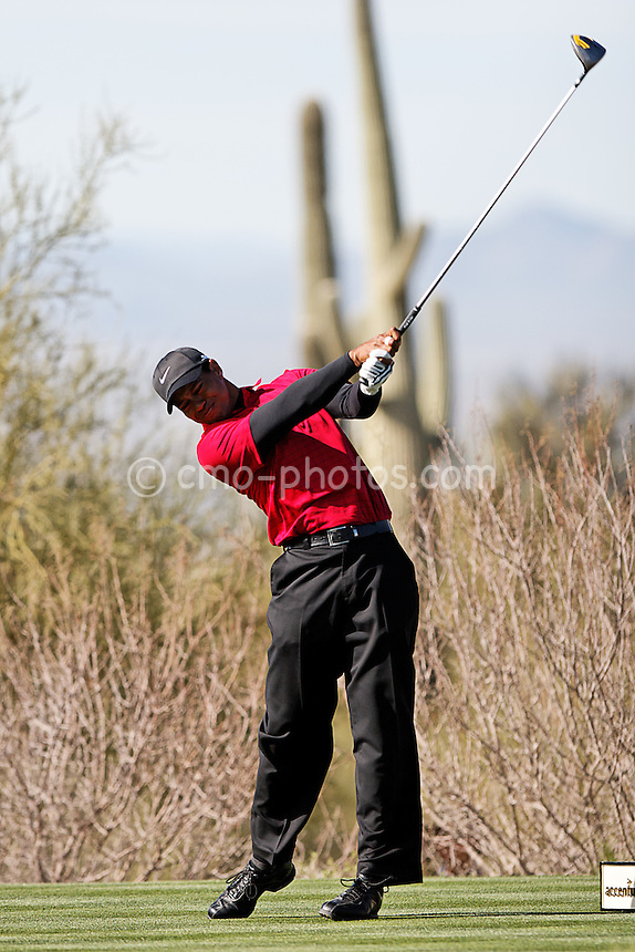 Feb 24, 2008; Marana, AZ, USA; Tiger Woods hits his tee shot on the drivable par-4 12th hole during his final-round match against Stewart Cink (not pictured) at the Accenture Match Play Championship at the Gallery Golf Club. Woods would go on to beat Cink 8 and 7 to earn his third victory in the WGC match play event and 15th victory overall in the World Golf Championship series.