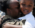 A tearful Lasonya Jones of Stratford, hugs her son Nassah Porter, 4,  Thursday, August 15, 2013, at the Air National Guard base in East Granby.  About 160 Connecticut National Guard soldiers of the 1048th Transportation Company of Stratford were welcomed home from Afghanistan after an 11 month deployment.  (Jim Michaud / Journal Inquirer)