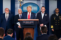 United States President Donald J. Trump, surrounded by members of the White House Coronavirus Task Force, delivers remarks on the pandemic in the press briefing room of the White House in Washington, DC, USA, 22 March 2020. Efforts to contain the coronavirus COVID-19 pandemic have caused travel disruptions, sporting event cancellations, runs on cleaning supplies and food and other inconveniences.United States President Donald J. Trump speaks during the daily briefing on the Coronavirus Pandemic from the Brady Press Briefing Room if the White House in Washington, DC on Sunday, March 22, 2020.  Standing behind the President, from left to Right: Director of the Centers for Disease Control and Prevention Dr. Robert Redfield; US Vice President Mike Pence; Pete Gaynor, Administrator, Federal Emergency Management Agency (FEMA); and US Surgeon General Vice Admiral (VADM) Jerome M. Adams, M.D., M.P.H.<br /> Credit: Jim LoScalzo / Pool via CNP/AdMedia