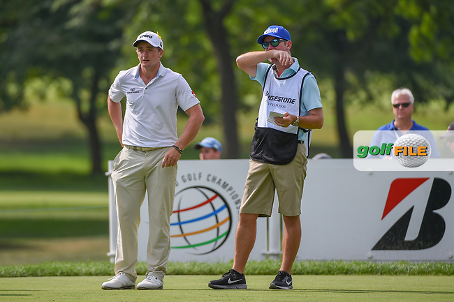 Paul Dunne (IRL) and his caddie look over his tee shot on 3 during 2nd round of the World Golf Championships - Bridgestone Invitational, at the Firestone Country Club, Akron, Ohio. 8/3/2018.<br />