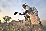 Lois Tumalu and other members of the United Methodist Women in Yei, Southern Sudan, prepare a plot of land to plant vegetables as part of a group food security project. Many of them widows, the women live precariously but at peace after having returned from refugee camps in neighboring Uganda and the Congo in recent years. A 2005 Comprehensive Peace Agreement laid the foundations for peace in Sudan's south after decades of war. NOTE: In July 2011, Southern Sudan became the independent country of South Sudan