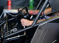 Mar 28, 2014; Las Vegas, NV, USA; NHRA funny car driver Alexis DeJoria warms up her car in the pits during qualifying for the Summitracing.com Nationals at The Strip at Las Vegas Motor Speedway. Mandatory Credit: Mark J. Rebilas-