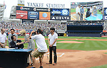 Hideki Matsui,<br /> JULY 28, 2013 - MLB :<br /> Hideki Matsui signs his reitement papers with Yankees assistant general manager Jean Afterman as his father Masao, brother and Yankees general manager Brian Cashman look on during his official retirement ceremony before the Major League Baseball game against the Tampa Bay Rays at Yankee Stadium in The Bronx, New York, United States. (Photo by AFLO)