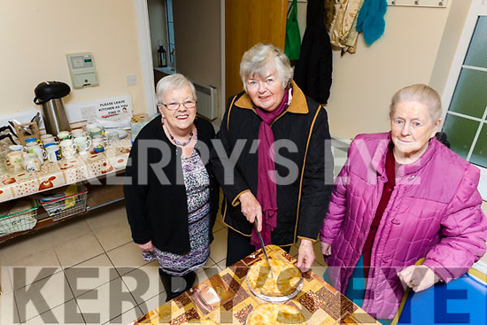 Catherine Aherne, Mavis Hall and Mary Kennelly of the Ballylongford Active Retirement group getting ready for the Coffee Morning in aid of the Irish Heart Foundation in the Parish Hall on Friday morning last.