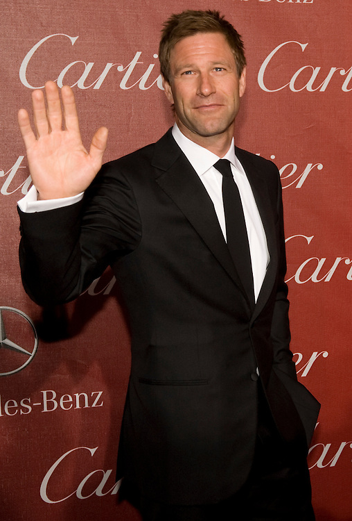 Aaron Eckhart waves to the cameras during the Palm Springs International Film Festival red carpet event at the Palm Springs Convention Center on Saturday. Eckhart played Harvey Dent a.k.a. Two-Face in Batman The Dark Knight.