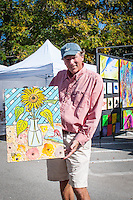 Artist Brian Kirkpatrick shows one of his works during the Naples Art Association's annual Art in the Park at The von Liebig Art Center, Naples, Florida, USA, Dec. 1, 2012. Photo by Debi Pittman Wilkey