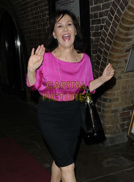 Arlene Phillips<br /> attended the &quot;WAG! The Musical&quot; press night, Charing Cross Theatre, The Arches, Villiers St., London, England, UK, 24th July 2013.<br /> half length pink top black skirt bag hand funny waving mouth open <br /> CAP/CAN<br /> &copy;Can Nguyen/Capital Pictures