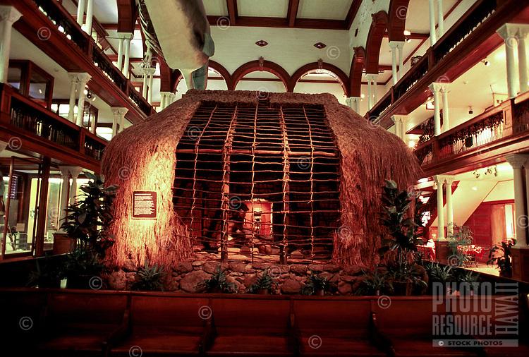 Traditional Hawaiian dwelling (thatched hut) inside the Bishop Museum in Honolulu, Oahu, Hawaii.