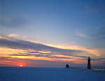 Grand Haven State Park, MI   <br /> Grand Haven Lighthouse and Lake Michigan under winter sunset clouds