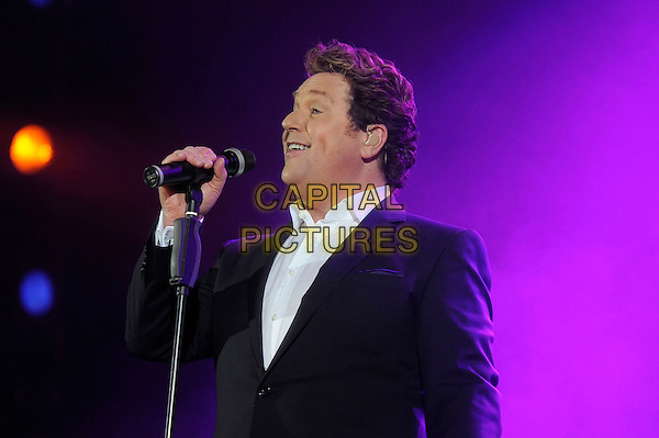 Michael Ball.performing in concert, Hammersmith Apollo, London, England.UK, 4th May 2013..music concert on stage live half length microphone suit shirt white gray grey side singing .CAP/MAR.© Martin Harris/Capital Pictures.