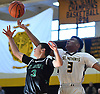 Matt Cruz of St. Joseph (Metuchen, NJ), left, and Andre Snoddy #3 of St. Anthony's battle for a rebound during a non-league boys basketball game iat St. Anthony's High School in South Huntington on Saturday, Dec. 29, 2018. Snoddy recorded 14 points and 12 rebounds in defeat as St. Joseph won by a score of 58-55.