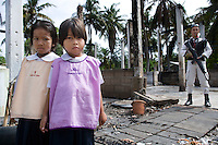 Children and armed police in the remainings of the Datoa school. It was recently heavily damaged in an arson attack. Thailand is struggling to keep up appearances as the land of smiles has to face up to its troubled south. Since 2004 more than 3500 people have been killed and 4000 wounded in a war we never hear about. In the early hours of January 4th 2004 more than 50 armed men stormed a army weapons depot in Narathiwat taking assault rifles, machine guns, rocket launchers, pistols, rocket-propelled grenades and other ammunition. Arsonists simultaneously attacked 20 schools and three police posts elsewhere in Narathiwat. The raid marked the start of the deadliest period of armed conflict in the century-long insurgency. Despite some 30,000 Thai troops being deployed in the region, the shootings, grenade attacks and car bombings happen almost daily, with 90 per cent of those killed being civilians. 24.09.07. Photo: Christopher Olssøn