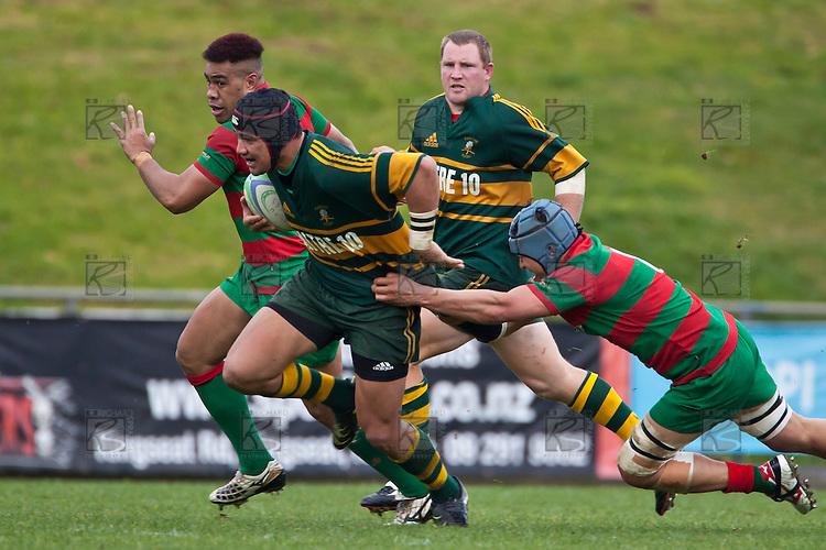 Maama Vaipula pushes off the tackle of Eli Peters.  . Counties Manukau McNamara Cup Premier Club Rugby final between Pukekohe andWaiuku, held at Bayer Growers Stadium, on Saturday July 17th. Waiuku won 25 - 20.