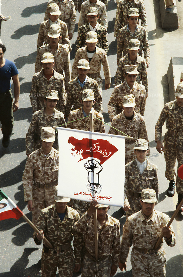 TEHRAN, IRAN - NOVEMBER 1979: A group of soldiers marching at the demonstration to support the U.S. hostage crisis which was a diplomatic crisis between Iran and the United States where 52 U.S. diplomats were held hostage for 444 days from November 4, 1979 to January 20, 1981, after a group of Islamist students took over the American embassy in support of the Iranian revolution. (Photo by Reza/ Webistan).<br />
