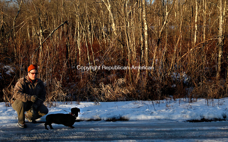 Morris, CT-07 January 2013-010713CM01 Ren Girdler of Morris stops with his dog, Steffi, a 10 year old Standard Dachshund, while going for a walk around the Morris Boat Landing Monday afternoon in Morris.  The pair were out enjoying a late afternoon sun.  Tuesday's forecast is expected to be sunny with a high near 41.  For a more detailed weather forecast, turn to page 8A.       Christopher Massa Republican-American