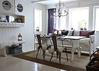 Two metal Toilx chairs accompany the more traditional styled dining table and wooden bench in the dining area