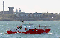 ItalyThe car ferry Norman Atlantic is seen on its way to Brindisi harbour, after a fire in waters off Greece January 2, 2015. <br /> pictured  firefighter's boat