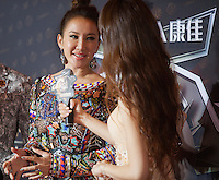 Coco Lee from Hong Kong, winner of the Most Stylish Asian Singer Award, is seen on the red carpet at the 18th Channel [V] China Music Awards and Asian Influential Power Grand Ceremony at the Venetian Macau Casino in Macau, China, 23 April 2014