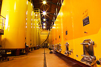 The wine cellar winery with enormous steel storage vats and conrete tanks at Chateau des Fines Roches, Chateauneuf-du-Pape, Vaucluse, Rhone, Provence, France