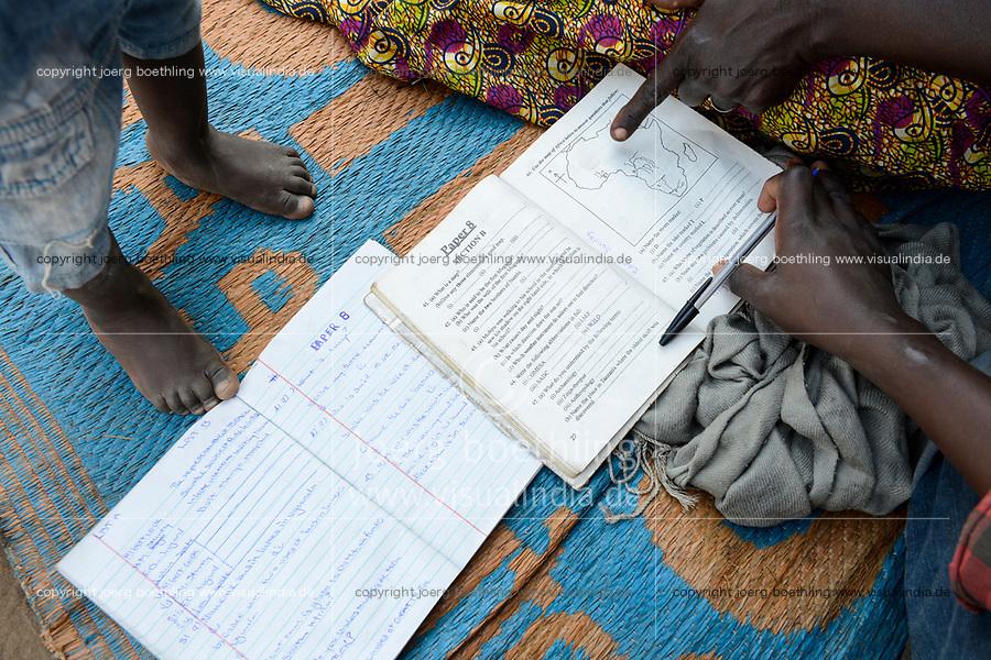 UGANDA, Arua, Yumbe, south sudanese refugees in Bidi Bidi refugee settlement, children with geography study book / suedsudanesische Fluechtlinge im Fluechtlingslager Bidi Bidi, Kinder mit Geographie Buch