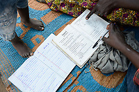 UGANDA, Arua, Yumbe, south sudanese refugees in Bidi Bidi refugee settlement, children with geography study book / suedsudanesische Fluechtlinge im Fluechtlingslager Bidi Bidi, Kinder mit Geographie Buch