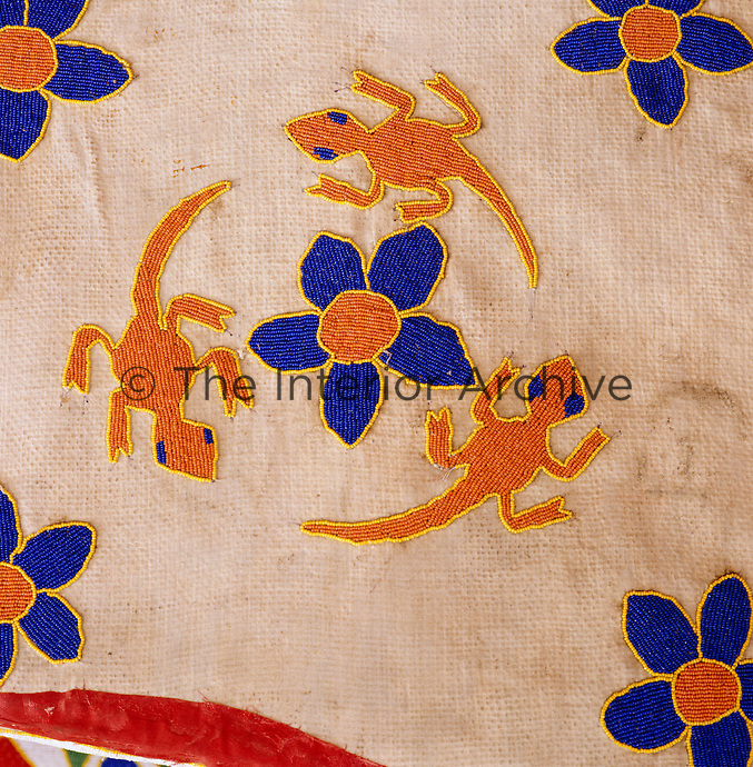 Detail of a lizard and flower motif on a beaded African chair