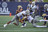 Annapolis, MD - September 8, 2018: Navy Midshipmen quarterback Malcolm Perry (10) is tackled by Memphis Tigers defensive back Josh Perry (4) during game between Memphis and Navy at  Navy-Marine Corps Memorial Stadium in Annapolis, MD. (Photo by Phillip Peters/Media Images International)