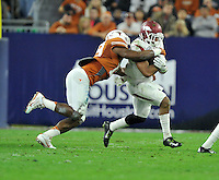 NWA Media/Michael Woods --12/29/2014-- w @NWAMICHAELW...University of Arkansas running back Jonathan Williams is tackled by Texas defender Peter Jinkens after a gain in the 1st quarter of the Texas Bowl Monday night at  NRG Stadium in Houston.