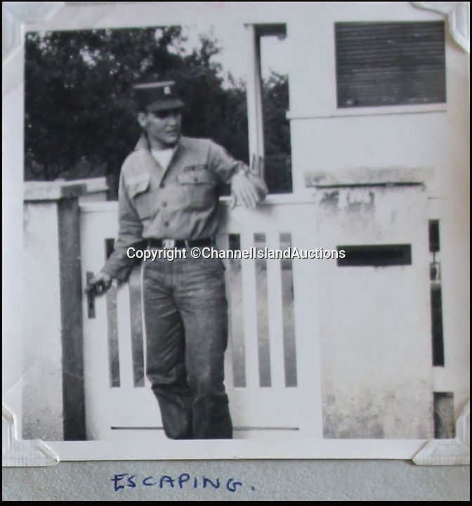 BNPS.co.uk (01202 558833)<br /> Pic: CIA/BNPS<br /> <br /> Elvis at the gate to his house in Bad Nauheim.<br /> <br /> A teenage girl's scrapbook containing unseen photos of Elvis Presley from his military service in Germany has been discovered after lying forgotten in a drawer for years.<br /> <br /> The owner compiled the album dedicated to the 'King' while she was working as a chambermaid in a hotel in Bad Nauheim, where Elvis spent most of his two years' national service.<br /> <br /> The book contains six signed photos of the star in his army uniform, signing autographs and posing with fans, including the owner of the album who was the only English girl in the town.
