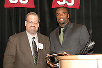 14 January 2007: Bob Zeimer presents an award to Michael Okwo at the annual football banquet at McCaw Hall in Stanford, CA.