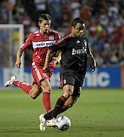 AC Milan midfielder Mancini (30) is pursued by Chicago Fire defender Krzysztof Krol (23).  AC Milan defeated the Chicago Fire 1-0 at Toyota Park in Bridgeview, IL on May 30, 2010.