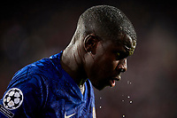 27th November 2019; Mestalla, Valencia, Spain; UEFA Champions League Footballl,Valencia versus Chelsea; Kurt Zouma of Chelsea throws water from a bottle on his face after an encounter with Ezequiel Garay of Valencia CF - Editorial Use