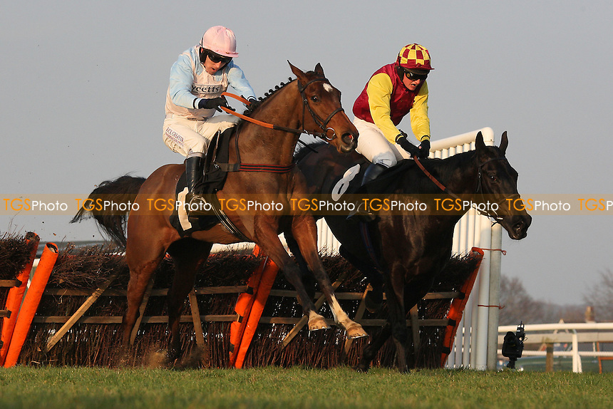 Race winner Gentleman Jimmy ridden by Ryan Mahon (R) jumps ahead of Well Mett ridden by Leighton Aspell during the Drive In Movie 18th August Handicap Hurdle - Horse Racing at Plumpton Racecourse, East Sussex - 12/03/12 - MANDATORY CREDIT: Gavin Ellis/TGSPHOTO - Self billing applies where appropriate - 0845 094 6026 - contact@tgsphoto.co.uk - NO UNPAID USE.