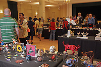 OrigamiUSA Convention 2015 Exhibition. Visitors brouse the exhibition. Models folded by Sara Adams, Germany, in the foreground.