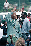 DURBAN, SOUTH AFRICA - APRIL 21: Nelson Mandela acknowledges a crowd of ANC supporters April 21, 1994 in Durban, South Africa. The pre-election rally is just days before the historic democratic election on April 27, 1994 that Mr. Mandela won. Mr. Mandela became the first black democratic elected president in South Africa. He retired from office after one term in June 1999. (Photo by Per-Anders Pettersson)