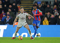 Burnley's Ashley Barnes battles with Crystal Palace's Wilfried Zaha<br /> <br /> Photographer Ashley Crowden/CameraSport<br /> <br /> The Premier League - Crystal Palace v Burnley - Saturday 13th January 2018 - Selhurst Park - London<br /> <br /> World Copyright &copy; 2018 CameraSport. All rights reserved. 43 Linden Ave. Countesthorpe. Leicester. England. LE8 5PG - Tel: +44 (0) 116 277 4147 - admin@camerasport.com - www.camerasport.com