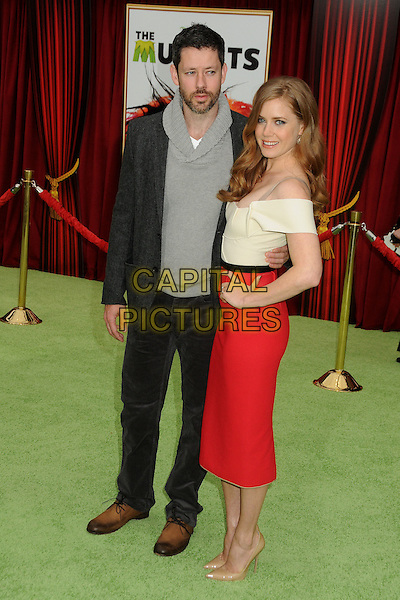 "Darren Le Gallo & Amy Adams.""The Muppets"" Los Angeles Premiere held at the El Capitan Theatre, Hollywood, California, USA..November 12th, 2011.full length white top red skirt hand on hip off the shoulder nude shoes black jacket trousers grey gray top couple beard side facial hair .CAP/ADM/BP.©Byron Purvis/AdMedia/Capital Pictures."