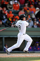 Shortstop Marcus Mooney (8) of the South Carolina Gamecocks bats in the Reedy River Rivalry game against the Clemson Tigers on Saturday, February 28, 2015, at Fluor Field at the West End in Greenville, South Carolina. South Carolina won, 4-1. (Tom Priddy/Four Seam Images)