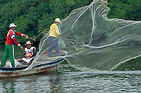 Fishermen throwing their net