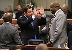 Nevada Sen. Michael Roberson, R-Las Vegas, talks with Assembly Majority Leader William Horne, D-Las Vegas, before U.S. Senate Majority Leader Harry Reid's address at the Legislature, in Carson City, Nev., on Wednesday, Feb. 20, 2013. .Photo by Cathleen Allison