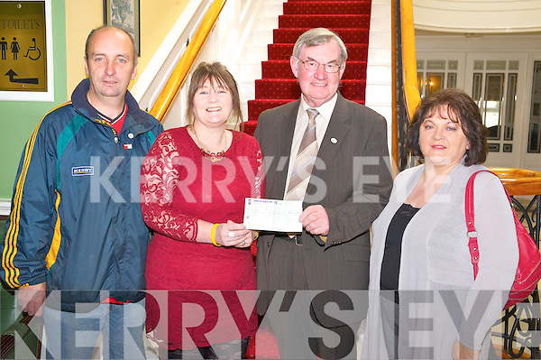 Mary Culloty O'Sullivan pictured as she presented a cheque for €1,200 to Michael Egan, Living Links National Co-ordinator, in the Dromhall Hotel, Killarney on Friday. Also pictured are Paul O'Sullivan and Maureen Egan.