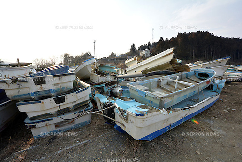 March 8, Minami-Sanriku, Japan - Abandoned fishing boats are neatly stack up waiting to be disposed in this seaside community of Shizugawa, Miyagi Prefecture on March 8. The community located deep inside an estuary by the Pacific Ocean was destroyed when the Magnitude 9.0 earthquake and ensuing mounds of tsunami struck the nation's northeast region, leaving more than 15,000 people dead and ravaging wide swaths of coastal towns and villages two years ago on March 11.  (Photo by Natsuki Sakai/AFLO)
