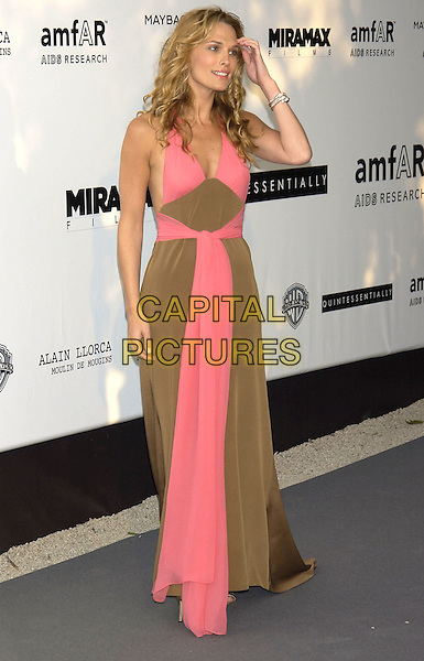 MOLLY SIMMS.arrivals at  amfAR 's Cinema Against Aids 2004.at Le Moulin de Mougins .Cannes Film Festival, France 20 May 2004..full length pink and brown halterneck dress.sales@capitalpictures.com.www.capitalpictures.com.©Capital Pictures