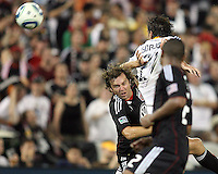 Carey Talley #8 of D.C. United heads the ball away from Alan Gordon #21 of the Los Angeles Galaxy during an MLS match at RFK Stadium on July 18 2010, in Washington D.C. Galaxy won 2-1.